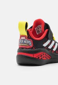 adidas Performance - FORTARUN SUPERHERO UNISEX - Chaussures de running neutres - core black/footwear white/vivid red - 5