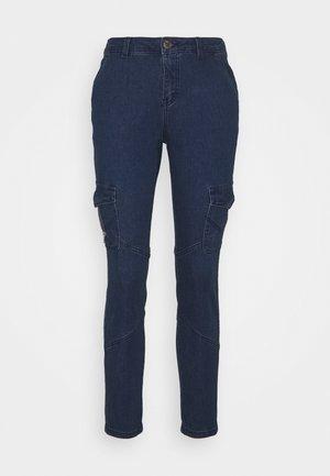 CUAMPEL PANTS - Slim fit jeans - blue wash