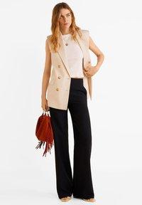 Mango - SIMON - Spodnie materiałowe - black - 1
