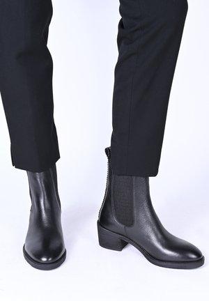 JENNA - Korte laarzen - schwarz