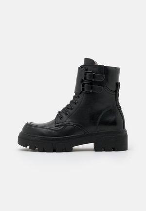 VEGAN HANNA AISTONE - Platform ankle boots - black
