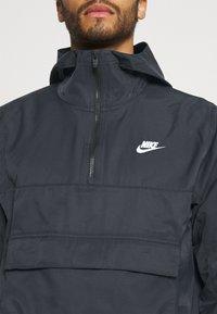 Nike Sportswear - ANORAK  - Windbreaker - black - 4