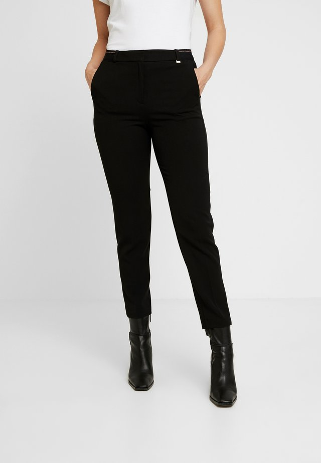 FORMAL JOGGER - Trousers - black