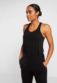 Nike Performance - Jumpsuit - black/dark smoke grey - 3