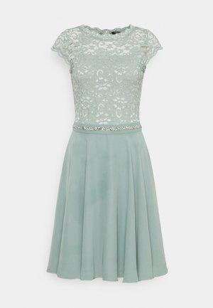 Sukienka koktajlowa - pistazie