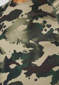 Nike Performance - SLIM CAMO - Print T-shirt - galactic jade/baroque brown - 4