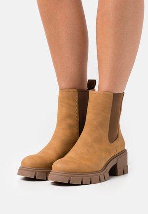VEGAN LOGANN - Platform ankle boots - beige