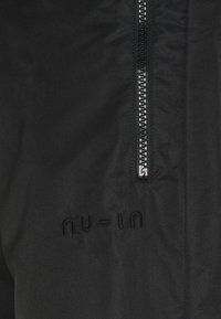 NU-IN - SHELL JOGGERS - Tracksuit bottoms - black - 4