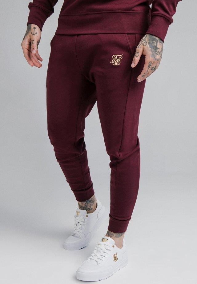 SIGNATURE TRACK PANTS - Teplákové kalhoty - wine