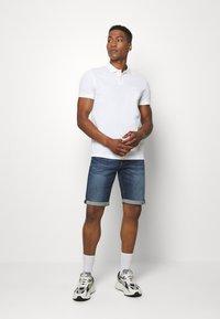 Tommy Jeans - Szorty jeansowe - blue denim - 1