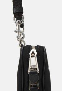 MOSCHINO - SHOULDER BAG UNISEX - Across body bag - black - 8