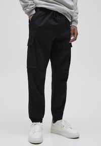 PULL&BEAR - Pantalon cargo - dark grey - 0