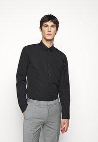 HUGO - Koszula biznesowa - black - 0