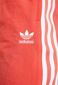 adidas Originals - LOCK UP ADICOLOR NYLON TRACK PANTS - Tracksuit bottoms - trace scarlet/white - 5