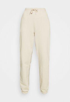 AMAZE - Teplákové kalhoty - beige