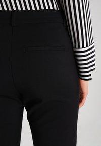 Vero Moda - VMVICTORIA - Spodnie materiałowe - black - 5