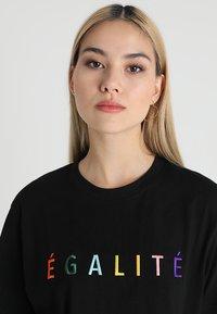 Merchcode - EGALITE TEE - Print T-shirt - black - 4