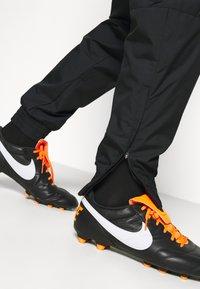 Nike Performance - LIVERPOOL PANT - Tracksuit bottoms - black/white - 3