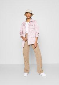 Nike Sportswear - Summer jacket - champagne - 1