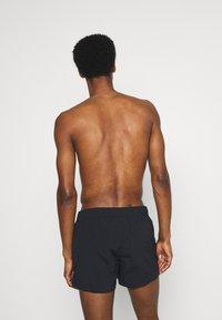 Champion - BEACH - Swimming shorts - black - 1