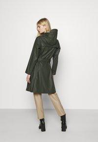 KnowledgeCotton Apparel - JASMINE LONG RAIN JACKET - Waterproof jacket - forrest night - 2