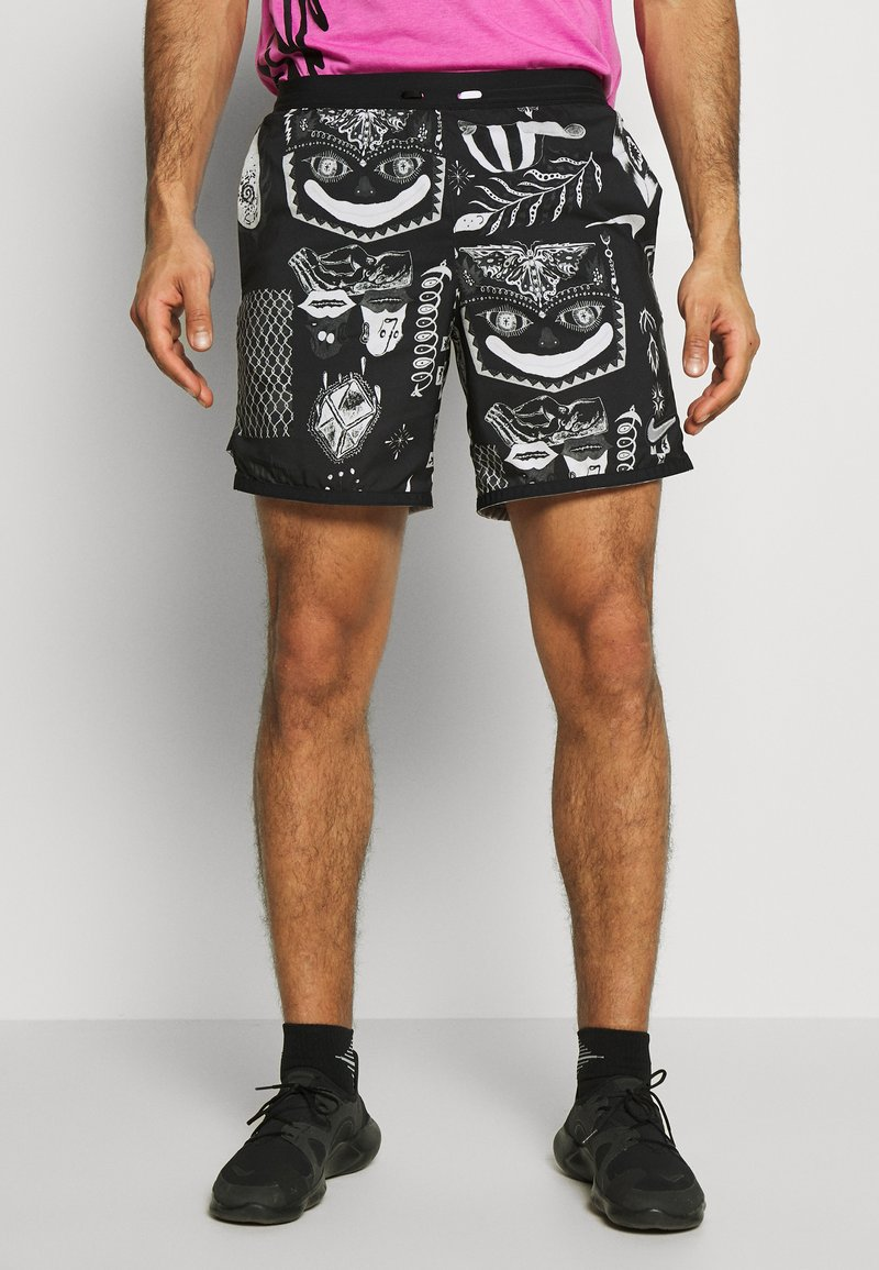 Nike Performance - WILD RUN - Sports shorts - black