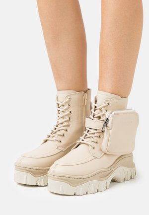 JAXSTAR - Lace-up ankle boots - camel