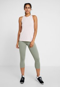 Nike Performance - TANK ALL OVER  - Sports shirt - echo pink/white - 1