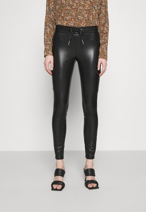 ONLZABO STRING - Leggings - black