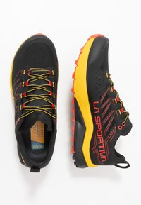 La Sportiva - JACKAL - Trail running shoes - black/yellow