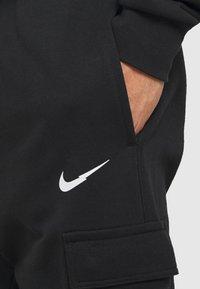 Nike Sportswear - PANT - Pantalones deportivos - black - 4