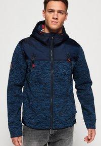 Superdry - MOUNTAIN - Zip-up hoodie - indigo navy marl - 0