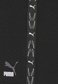 Puma - ELEVATE - Korte sportsbukser - black - 2