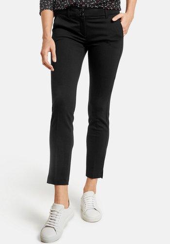 FREIZEIT SKINNY LOW - Trousers - black