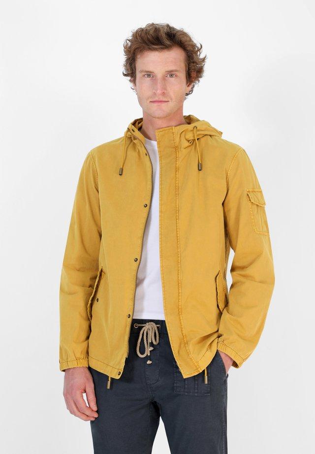 Jas - mustard yellow
