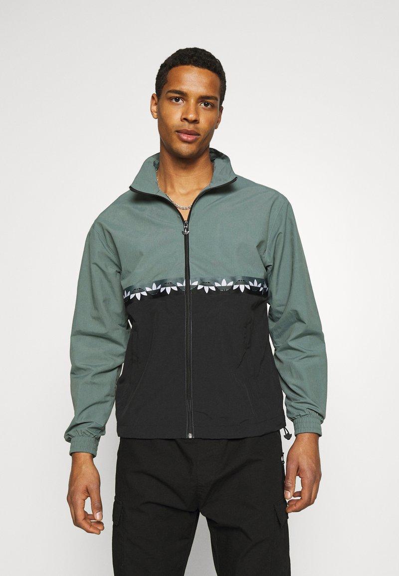 adidas Originals - SLICE - Training jacket - black/blue oxide