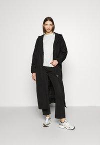 Weekday - MAY LONG JACKET - Winter coat - black - 1