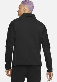 Nike Sportswear - M NSW TCH FLC LS FNL - Sweatshirt - black/black - 2