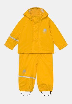 BASIC RAINWEAR SOLID SET UNISEX - Rain trousers - yellow
