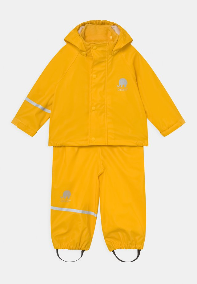 BASIC RAINWEAR SOLID SET UNISEX - Vodotěsná bunda - yellow