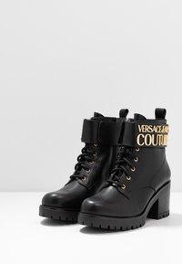 Versace Jeans Couture - Kotníková obuv - black - 4