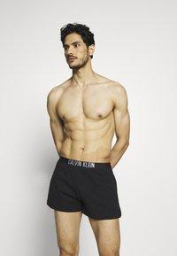Calvin Klein Swimwear - INTENSE POWER SHORT - Shorts da mare - black - 0