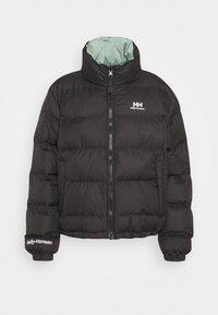 Helly Hansen - REVERSIBLE PUFFER JACKET - Winter jacket - black - 0