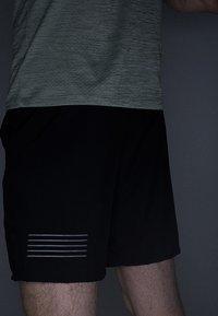 Salomon - XA TRAINING SHORT - Sportovní kraťasy - black - 5