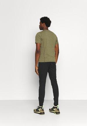 CORMAC PANT MENS - Tracksuit bottoms - black