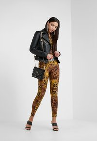 Versace Jeans Couture - Leggings - Trousers - gold - 1