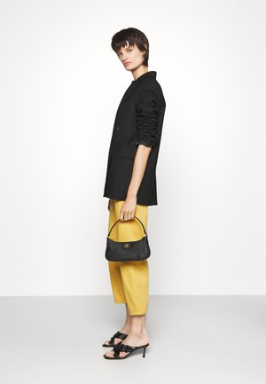 CAROL BAGUETTE - Handbag - black/gold