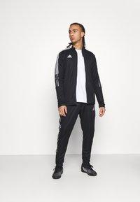 adidas Performance - TIRO - Träningsbyxor - black - 1