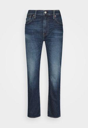 502 TAPER - Slim fit jeans - dark indigo