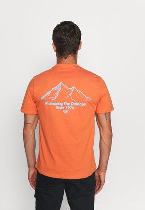 LUIZ - T-shirt print - arabesque